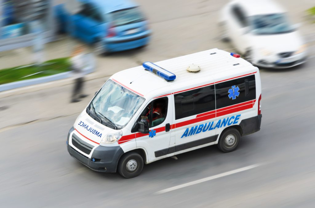 Ambulance passing the highway.