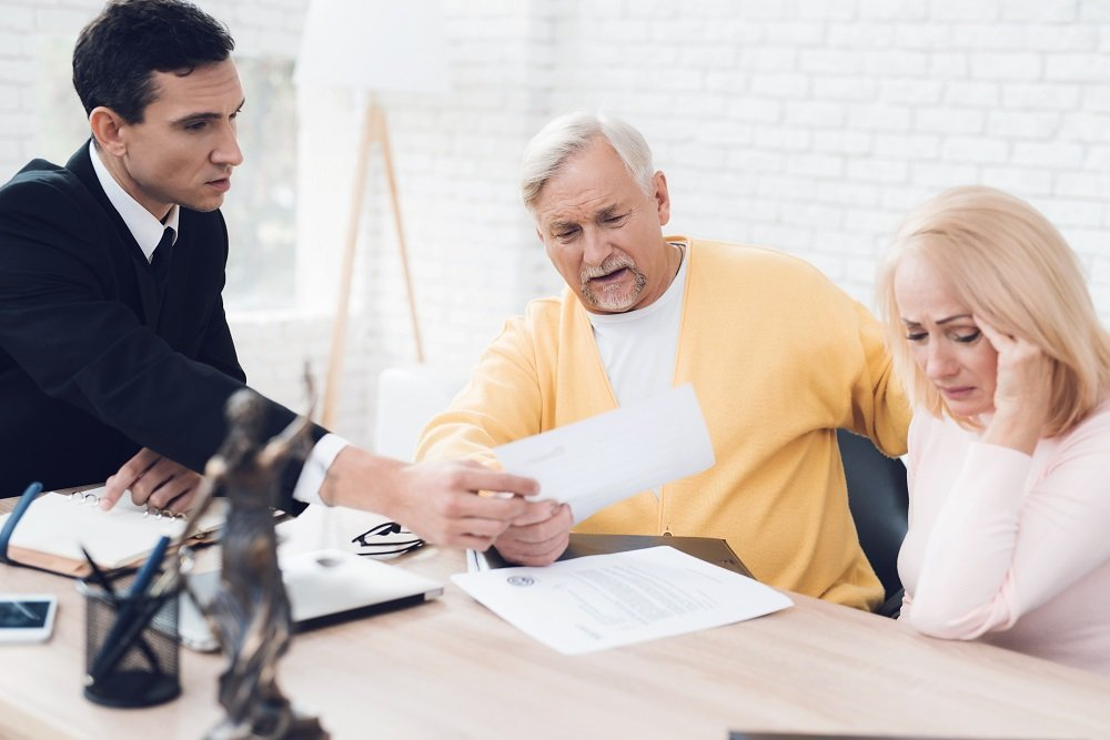 Couple consulting real estate lawyer regarding the issues on trusts.