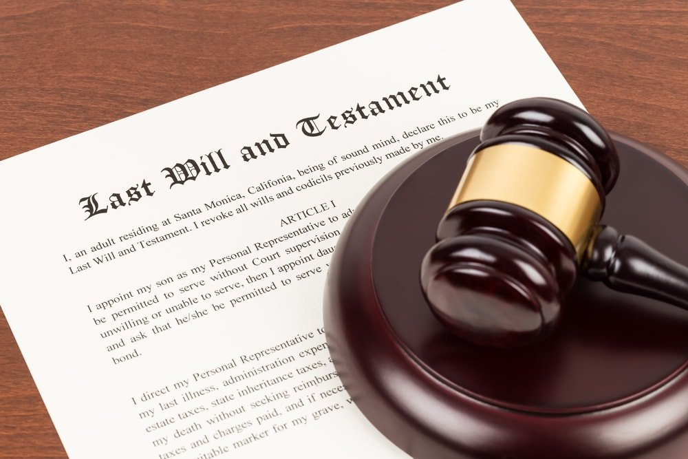 last will and testament with wooden gavel on top
